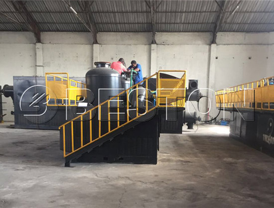 The workers are installing continuous pyrolysis equipment